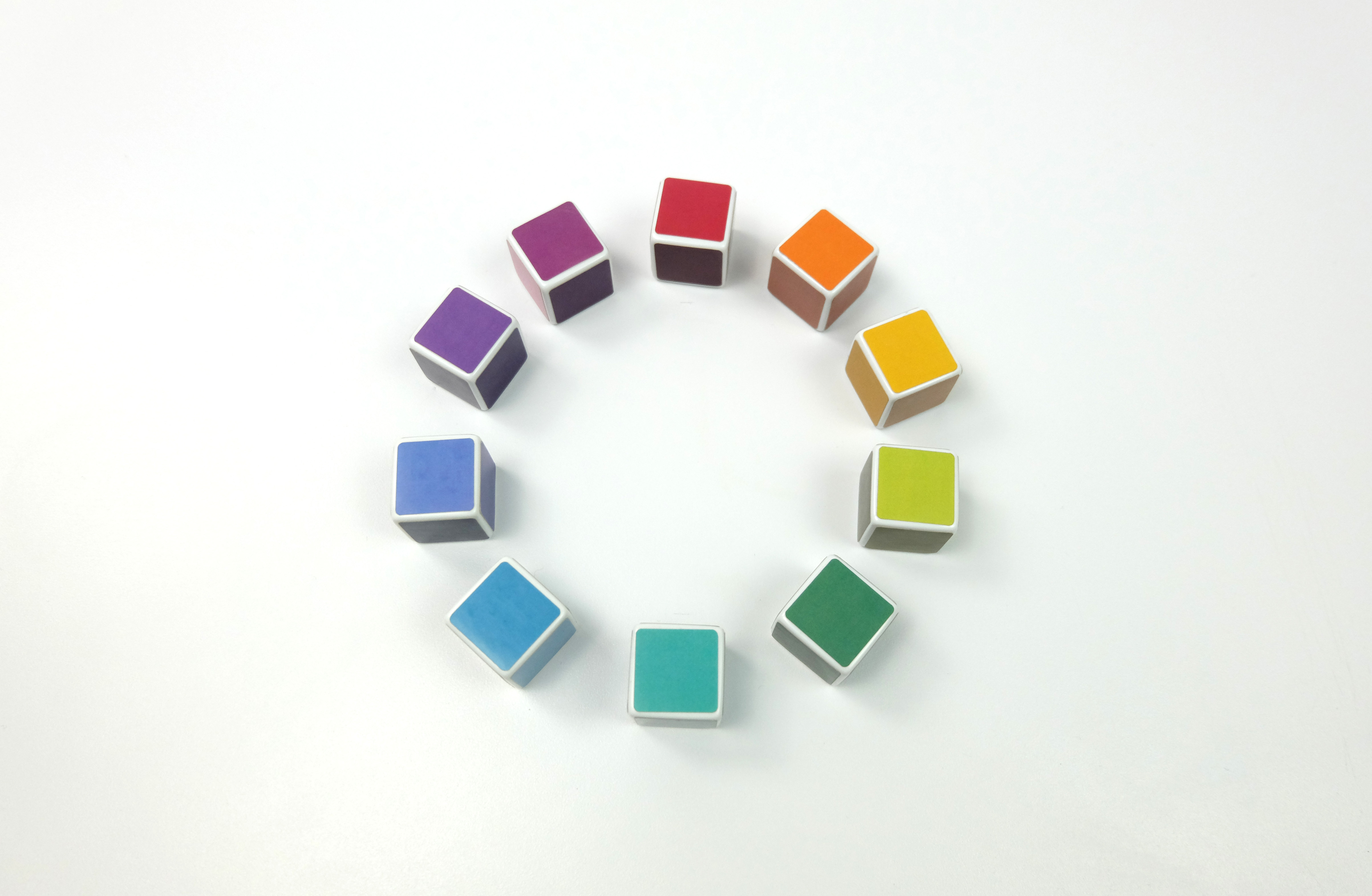 a spinning color wheel, where each color is made of dice.