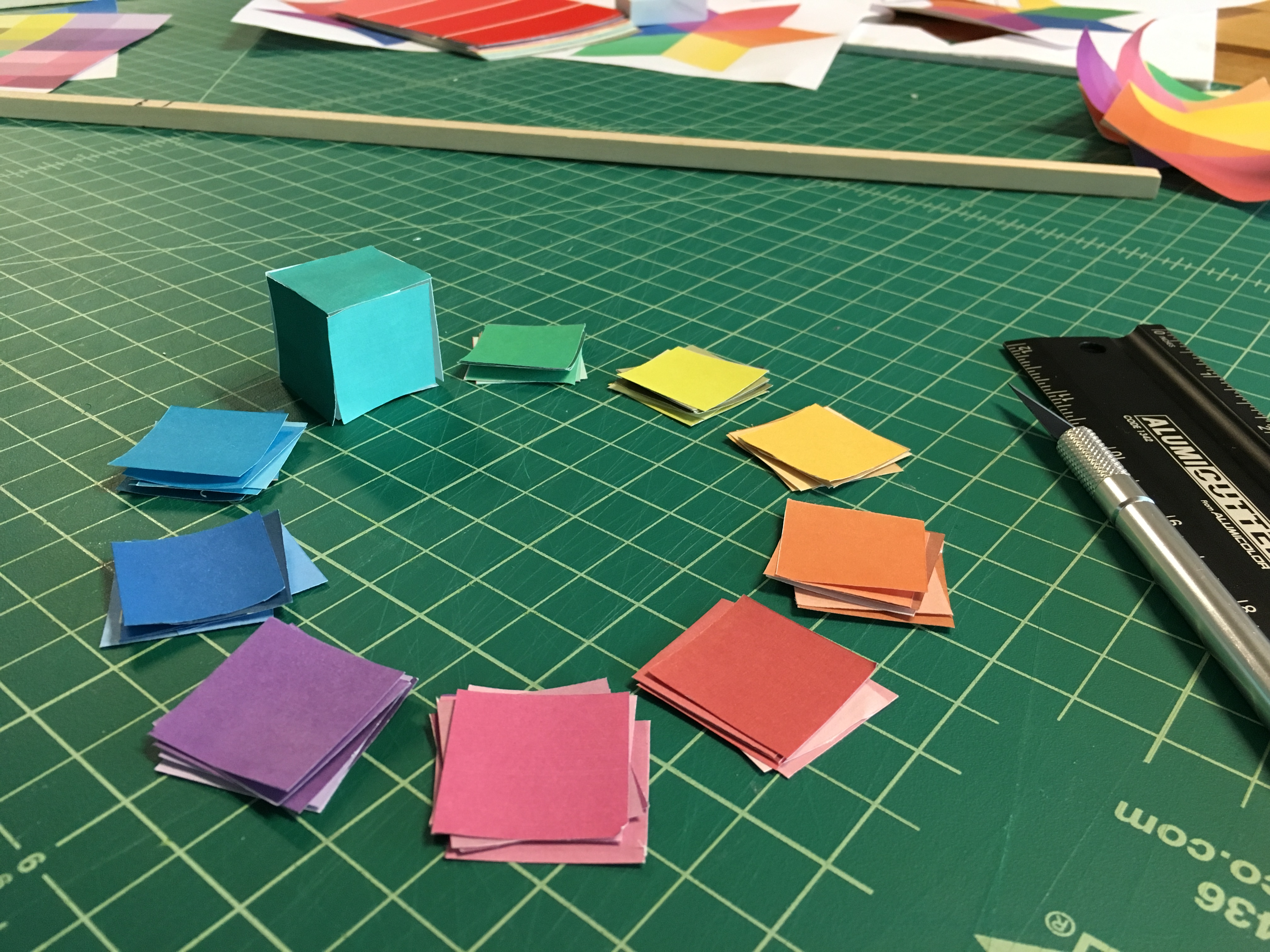 An early prototype of a color wheel made of dice, made of printed paper cut-outs glued together into cubes.